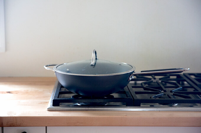 A wok on a stovetop.