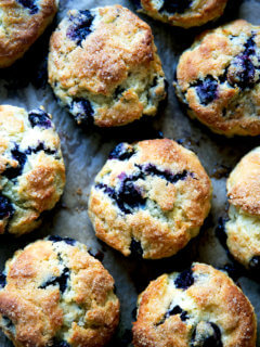 Just-baked Blueberry Scones on a sheet pan.