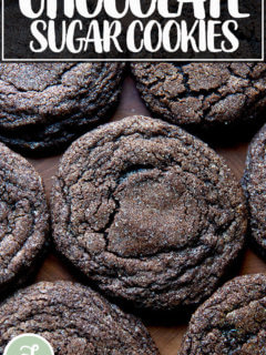 Baked chocolate sugar cookies on a board.