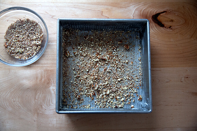 A 9-inch pan, buttere, and sprinkled with ground pecans.