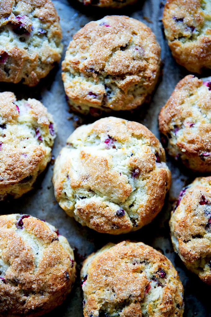Just-baked cranberry scones on a sheet pan.