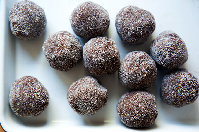 Portioned chocolate sugar cookie balls, rolled in sugar.