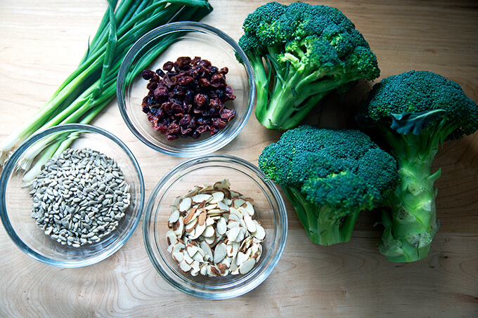 Ingredients for broccoli salad on countertop.