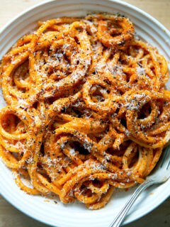 A bowl of bucatini tossed in Ina Gartens vodka sauce.