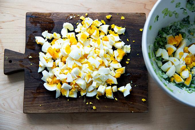 Chopped hard-boiled eggs on a board.