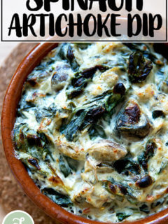 A small dish filled with spinach-artichoke dip just broiled.