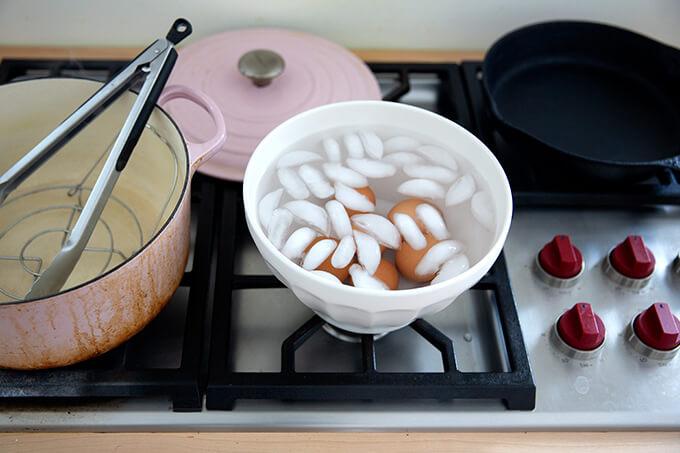 Steamed eggs in an ice bath.
