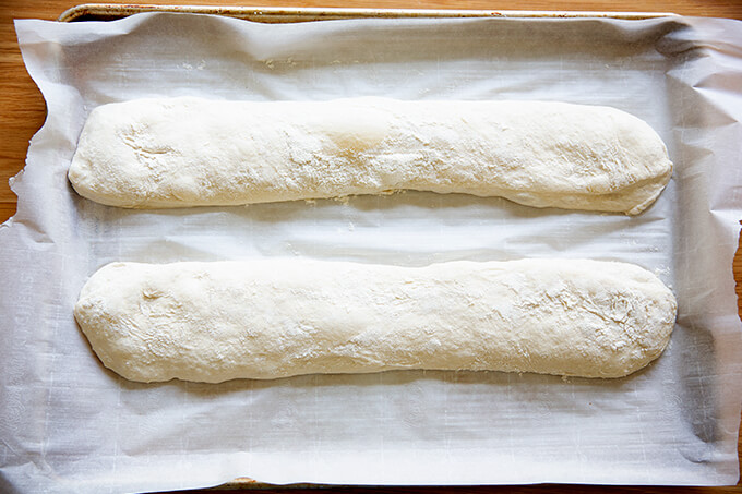 Ciabatta baguettes shaped on a sheet pan.