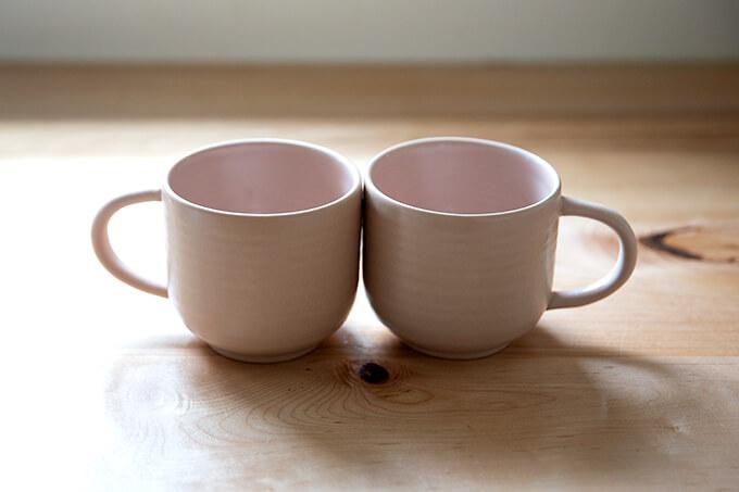 Two pink mugs.