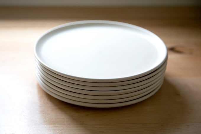 A stack of white plates.