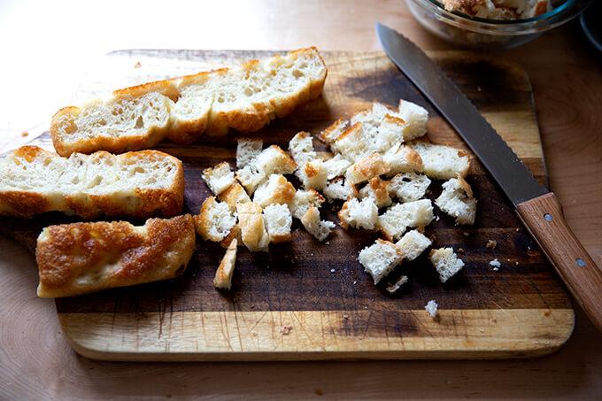 Cube focaccia bread on a board.