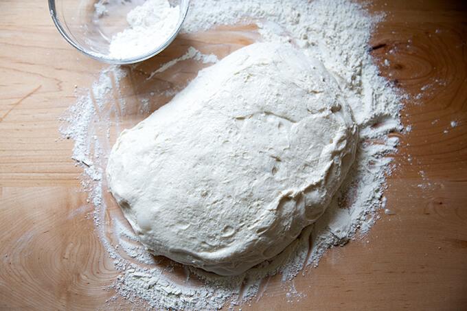A blob of sourdough ciabatta dough on the countertop.