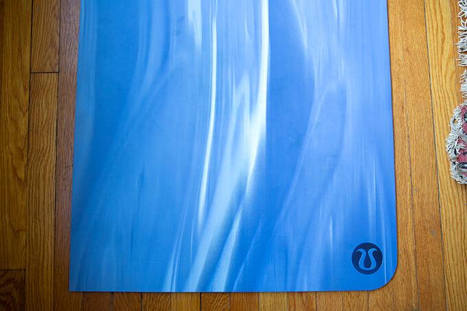 A blue Lululemon yoga mat.