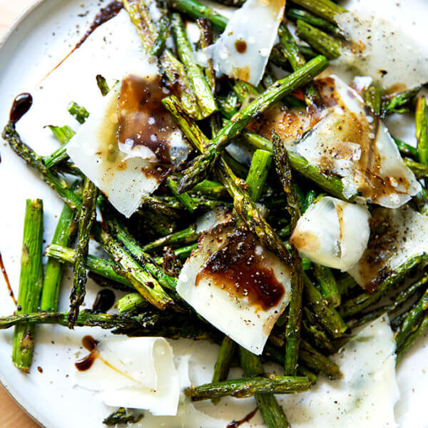 Roasted asparagus with balsamic and parmesan on a plate.