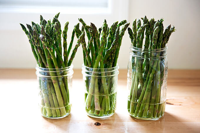 Asparagus in glass jars with a little bit of water.