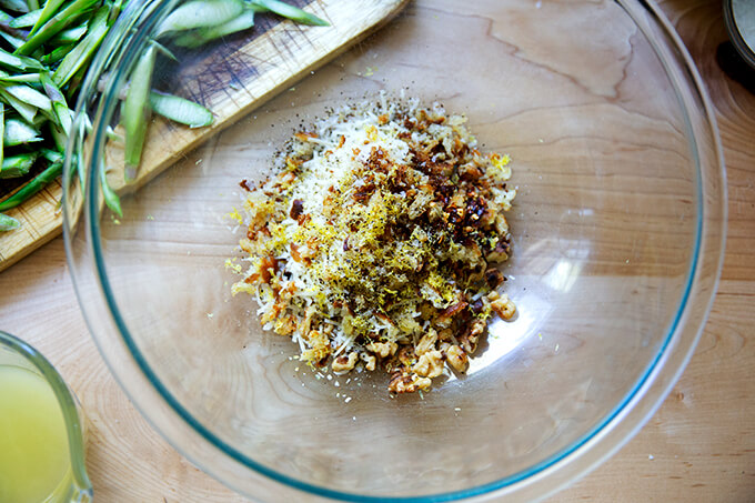 A mixture of walnuts, toasted bread crumbs, parmesan, and lemon.