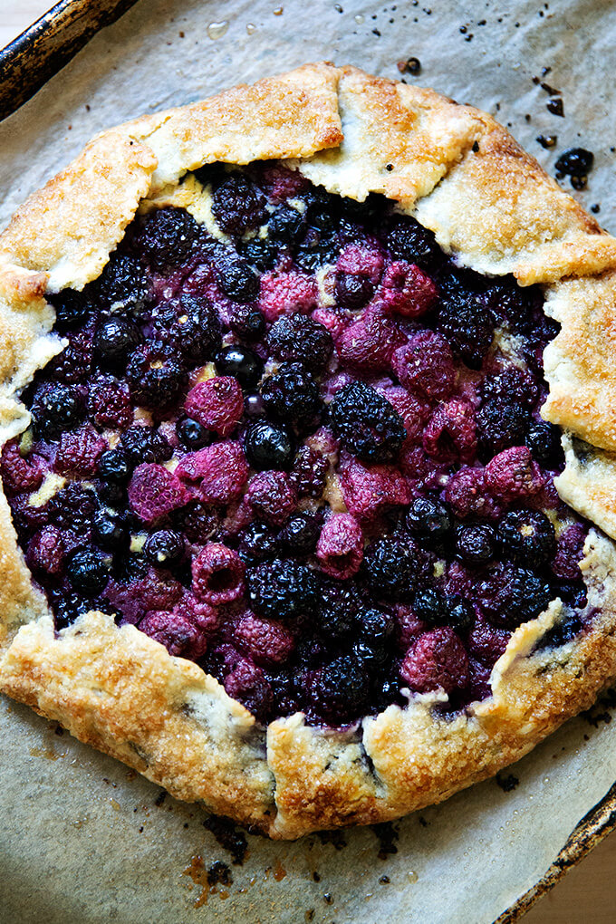 Mixed berry galette on a sheet pan.