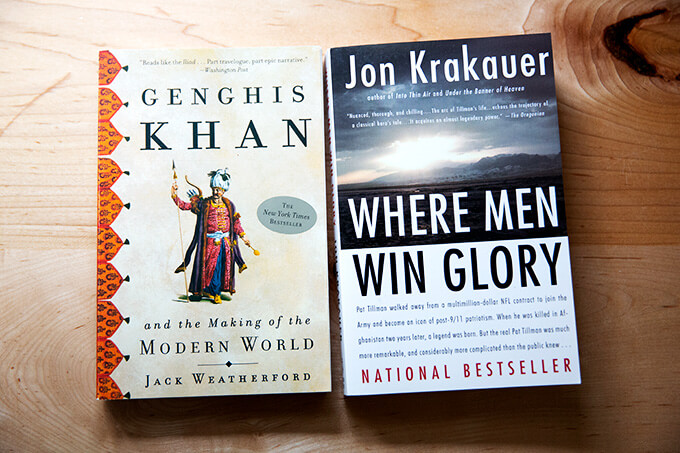 Two books on a counter: Genghis Khan and Where Men Win Glory