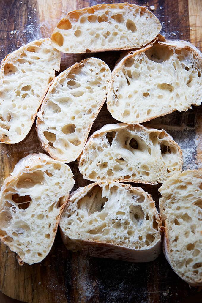 Sliced ciabatta bread on the counter top.