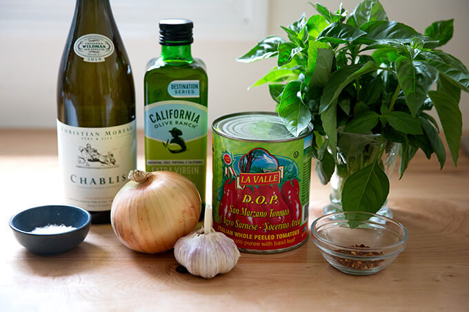 Ingredients to make quick, homemade tomato sauce from canned tomatoes.