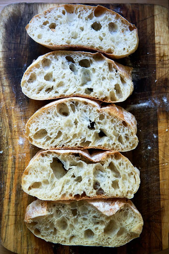 Sliced ciabatta bread on a board.