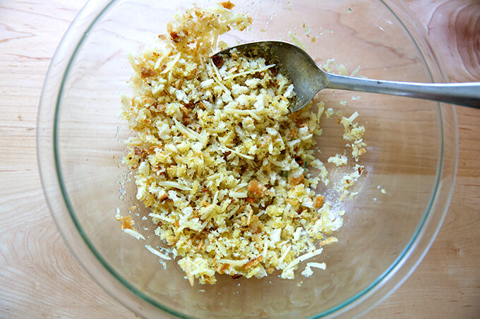 A bowl filled with the bread crumb topping for zucchini parmesan.
