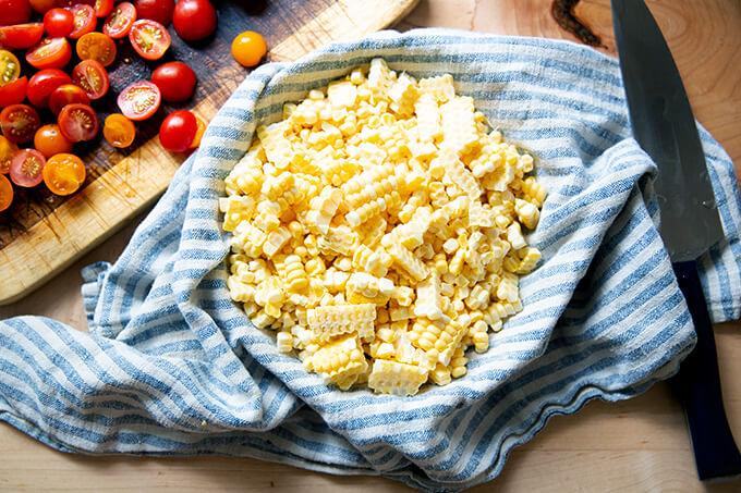 A bowl full of corn kernels.