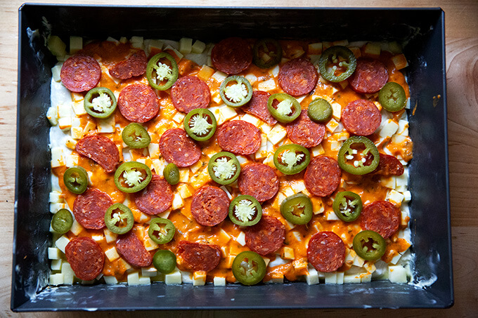 A pepperoni and pickled jalapeño Detroit style pizza, ready to be baked.