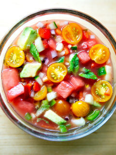A glass bowl filled with watermelon gazpacho.