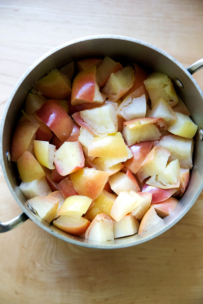 Cooked apples in a pot on a countertop.