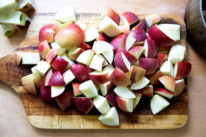 Cut apples on a board.