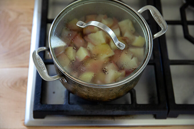 Cooked apples on the stovetop.