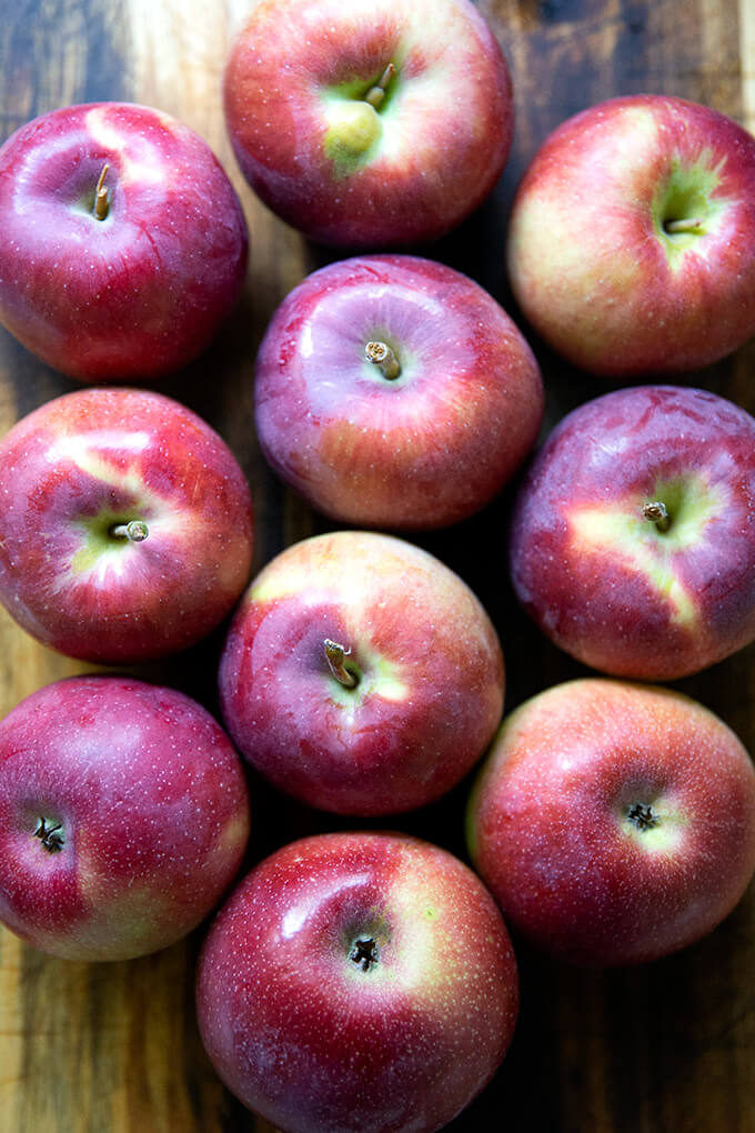 Empire apples on a board.