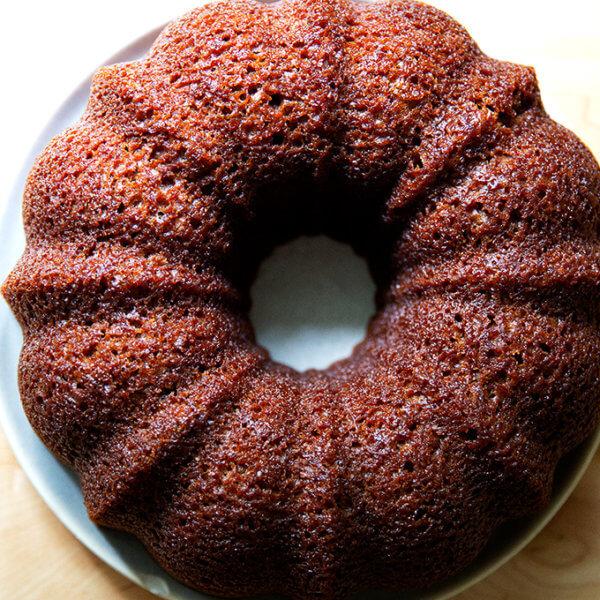 Just-baked applesauce bundt cake on a plate.