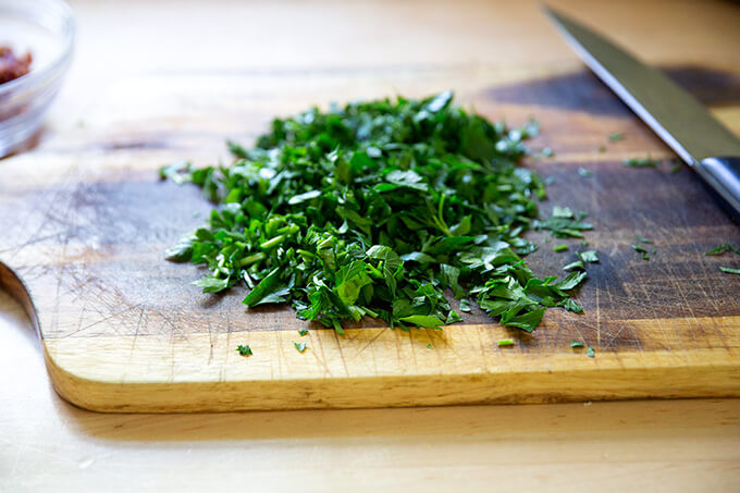 Chopped parsley on a board.