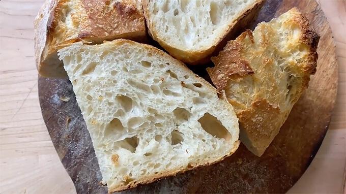 Sliced sourdough bread on a board.