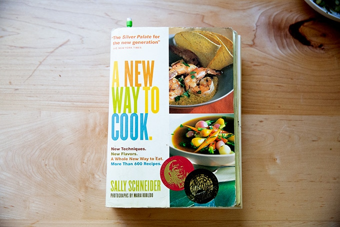 A cookbook, A New Way to Cook, on the counter.
