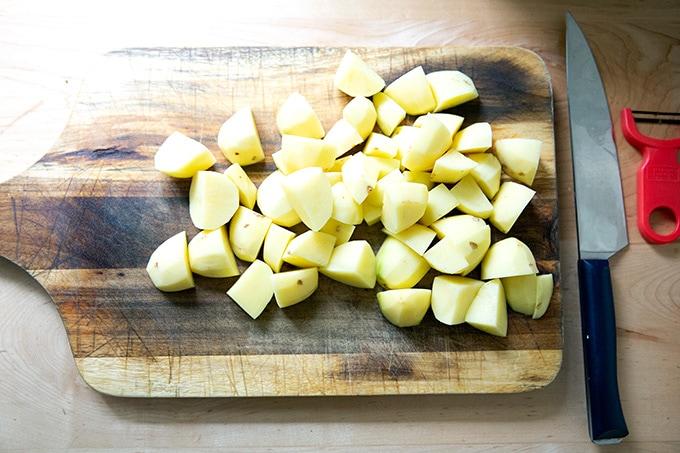 Peeled and cut Yukon Gold potatoes.