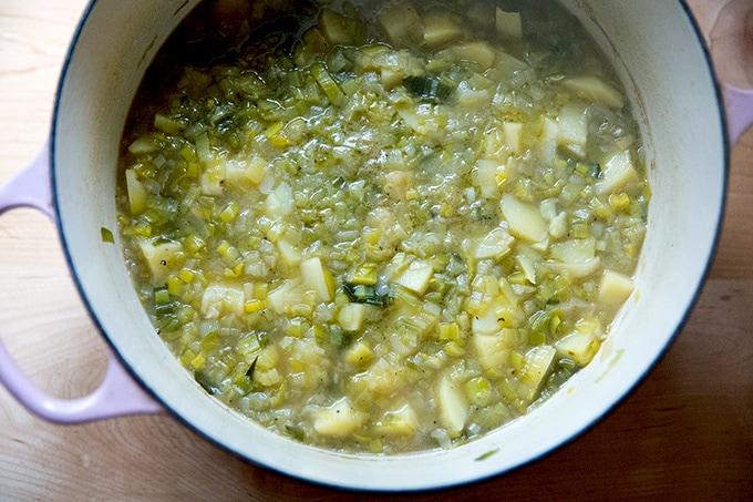 A large soup pot holding potato leek soup, ready to be puréed.